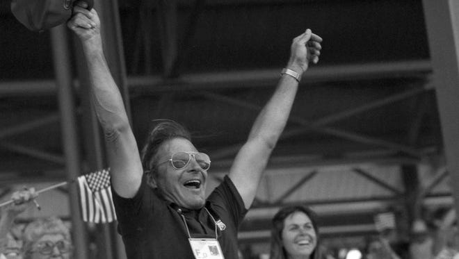 In this Aug. 7, 1984, file photo, Frank Chapot, coach of the U.S. equestrian jumping team, celebrates his team's gold medal win during the Summer Olympics at Santa Anita Park in Arcadia, Calif. The champion show jumper who competed in six Olympics before coaching the United States to Olympic gold has died. Chapot was 84.