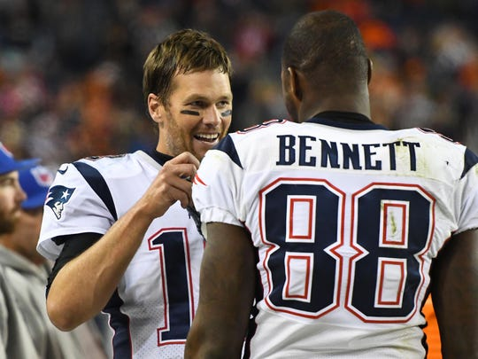 Tom Brady is certainly happy that he has Martellus Bennett back with the Patriots.