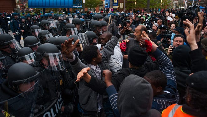 Demonstrators crowd in front of police officers during a demonstration outside of Camden Yards to protest the death of Freddie Gray in Baltimore.