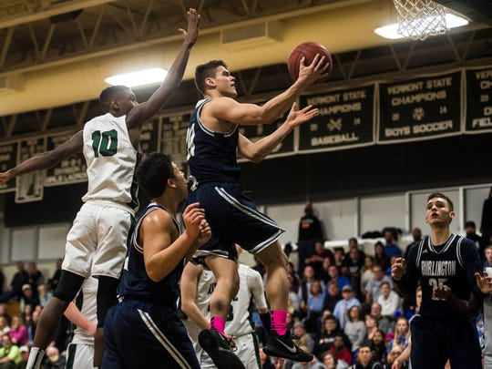BHS #24 Kevin Garrison slams makes a hole for the layup during their boy's basketball match up Thursday night, Feb. 22, 2018, at Rice.