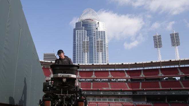 Grant McKnight of J&D Turf uses an ABI Force motorized infield groomer to break up frost in the dirt on the right field warning track in preparation for Opening Day at Great American Ball Park.