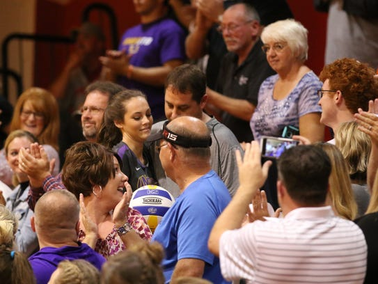 Unioto's Madi Eberst greets members of her family after