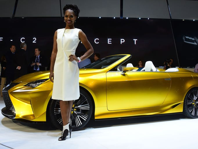 A model poses beside the just unveiled Lexus LF-C2