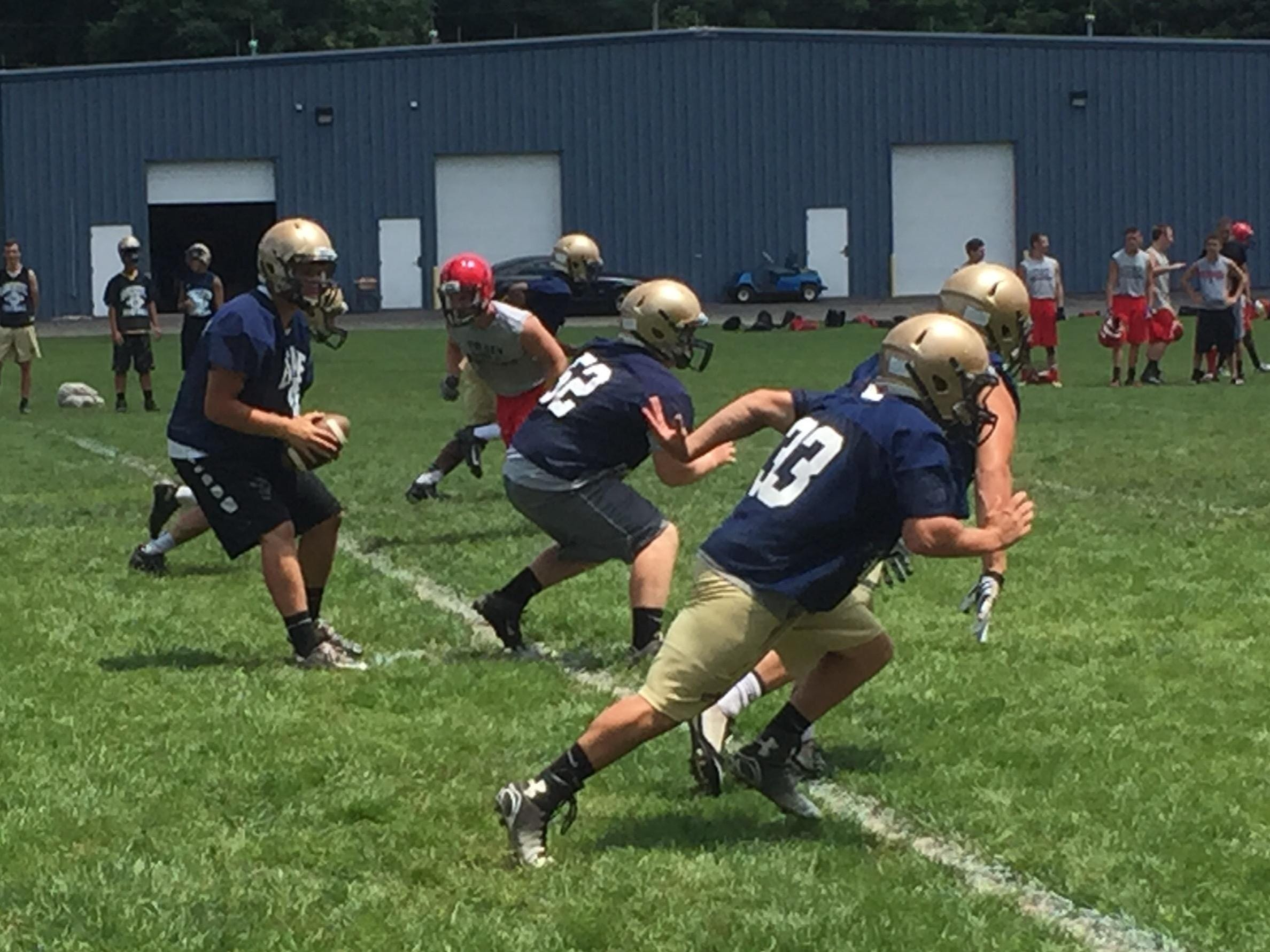 Lancaster quarterback J.D. Arbuckle drops back to pass during the Golden Gales' 7-on-7 passing scrimmage against Lima Shawnee on Wednesday.