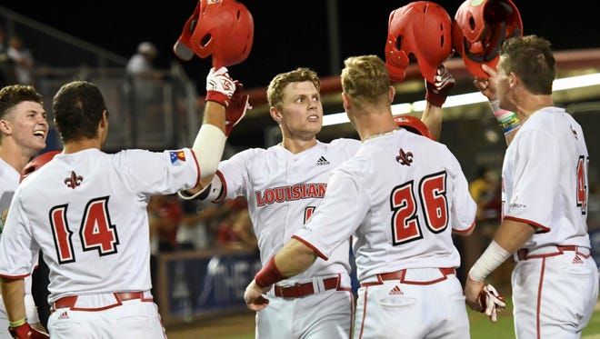"""UL's Hunter Kasuls celebrates with his teammates after hitting a grand slam in the bottom of the second inning of the Ragin' Cajuns game against Little Rock in the Sun Belt Tournament at M.L. """"Tigue"""" Moore Field at Russo Park in Lafayette on night Wednesday."""
