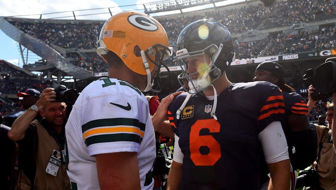 Chicago Bears quarterback Jay Cutler (6) and Green Bay Packers quarterback Aaron Rodgers (12) talk after a game at Soldier Field earlier this season.