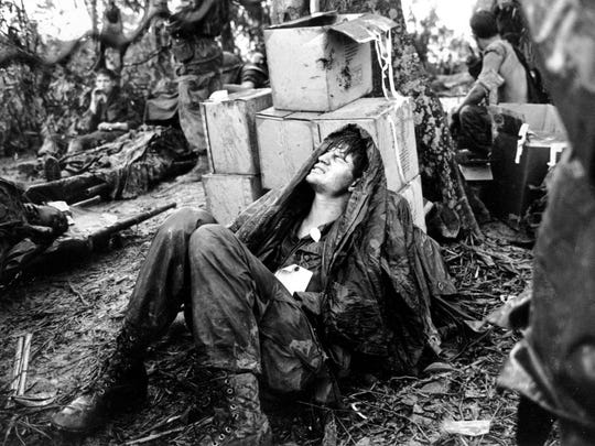 A  wounded U.S. paratrooper grimaces in pain as he awaits medical evacuation at base camp in the A Shau Valley near the Laos border in South Vietnam on May 19, 1969 during the Vietnam War.  The 101st Airborne Division attacked the North Vietnamese Communist forces at the 3,000-foot Ap Bia Mountain, or Hill 937, in the 10-day battle known as Hamburger Hill by the GIs.  Forty-six Americans were killed before the mountain was taken, and the death toll for North Vietnamese is around 517.