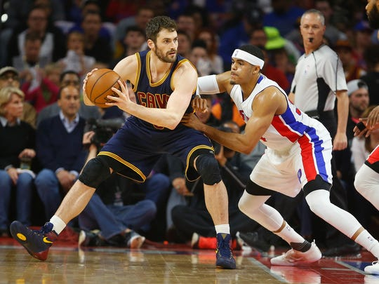 Kevin Love #0 of the Cleveland Cavaliers looks to make a move around Tobias Harris #34 of the Detroit Pistons during the first quarter of the NBA Eastern Conference quarterfinals at the Palace of Auburn Hills on April 22, 2016 in Auburn Hills, Michigan.
