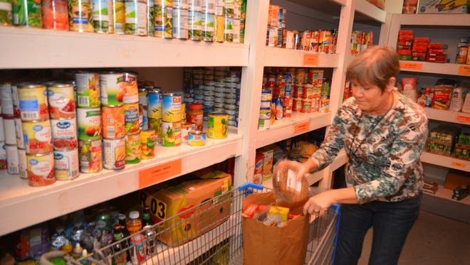 Sherrill Stramara, a volunteer at the Central Brevard Sharing Center, packs up bags of food for people in the pantry. The center received a $28,000 Brevard County community-based organization grant for the current budget year.