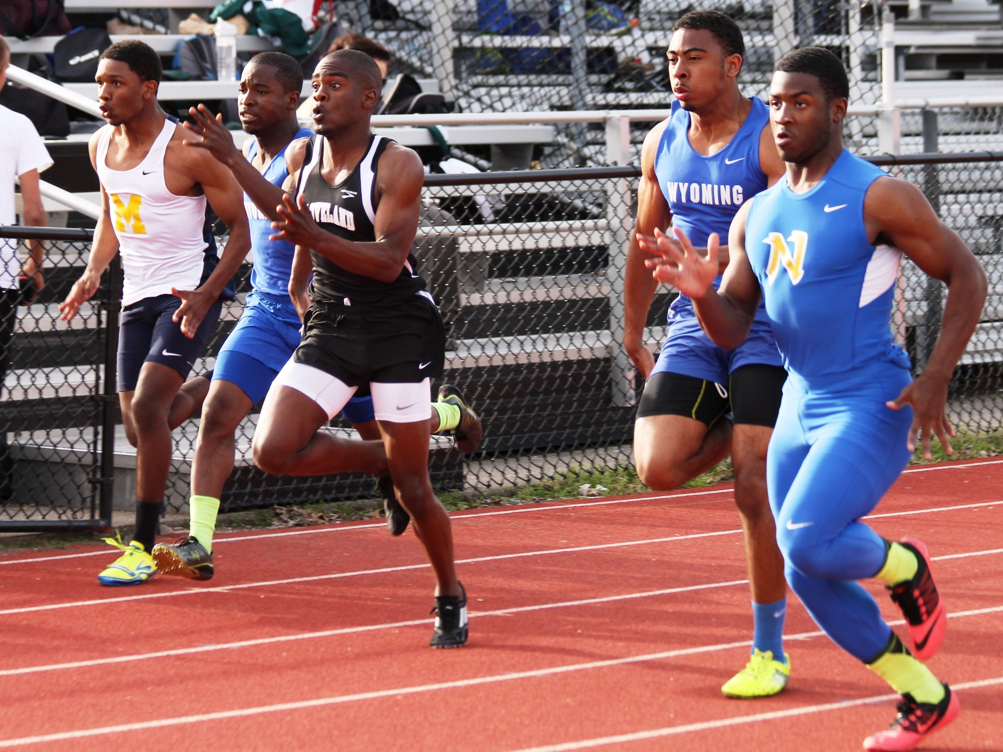 Northwest's DeVohn Jackson, right, is a three-time state qualifier and was a state champion in 4x100 meter relay in 2013.
