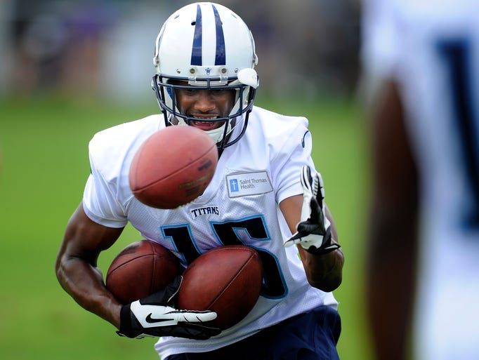 Tennessee Titans wide receiver Justin Hunter (15) pulls in a third ball during a receivers drill during practice at St. Thomas Sports Park Sunday July 27, 2014, in Nashville, Tenn.