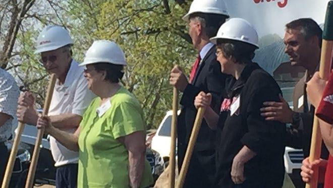 John Gagliardi, far left, wife Peg and St. John's University President Michael Hemesath, center, prepare to break ground Thursday on Gagliardi Field.