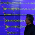 Earthquake and Volcano of the Korea Meteorological Administration Director General Yun Won-tae stands in front of a screen showing seismic waves that were measured in Seoul, South Korea, on Wednesday.