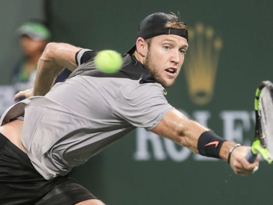 Jack Sock stretches to return the ball to Thomas Fabbiano, of Italy, during the men's 2nd round at the BNP Paribas Open on Sunday, March 11, 2018 in Indian Wells
