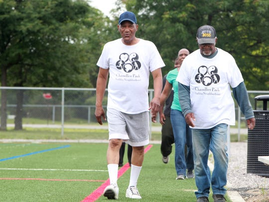 Jimmy Howard of Detroit and McClellan Mcvey of Detroit walk together during the morning walking group at Chandler Park on Friday, July 28, 2017.
