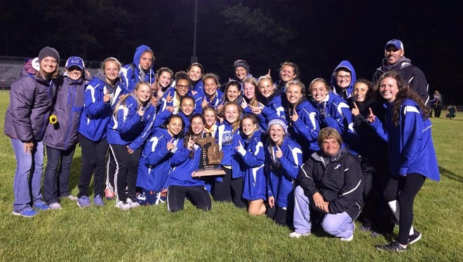 The Harper Creek girls track and field team celebrates its Division 2 regional championship on Friday.