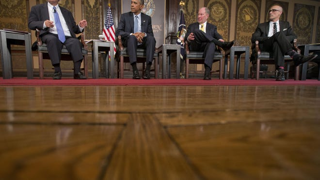 President Barack Obama, center, at the Catholic-Evangelical Leadership Summit on Overcoming Poverty at Georgetown University in Washington, Tuesday, May 12. With Obama are from left to right, E.J. Dionne, Jr., Washington Post columnist and professor in Georgetown's McCourt School of Public Policy, Robert D. Putnam, Professor of Public Policy at the Harvard University John F. Kennedy School of Government, and Arthur Brooks, president of the American Enterprise Institute.