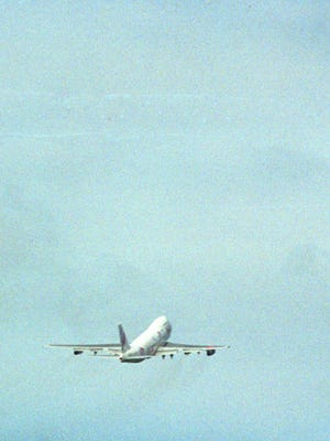 A commercial airplane takes off.