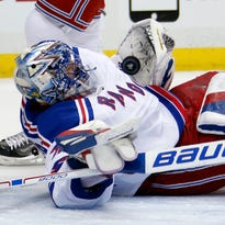 New York Rangers goalie Henrik Lundqvist sprawls to make a save during the second period Monday in Pittsburgh.
