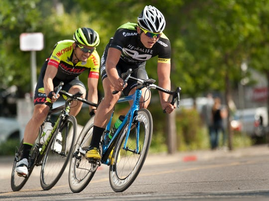 Matt Chatlaong, 23, leads through turn 2 in the Men Pro/1/2 race of the Sequoia Cycling Classic in Downtown Visalia on Sunday, April 26, 2015. Chatlaong placed first and rides with Herbalife presented by MarcPro-Strava.