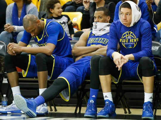 Delaware's (from left) Barnett Harris, Marvin King-Davis and Devonne Pinkard watch the final moments of overtime after fouling out of Delaware's 101-97 loss at Towson University Saturday.