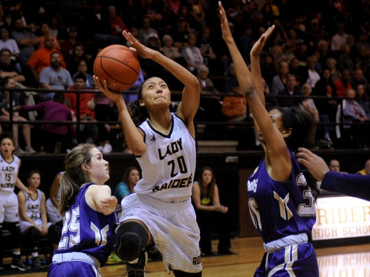 Rider's Jazmin Luster goes up to shoot between Denton