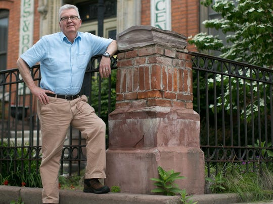 Joe Flaherty, founder and executive director of Writers & Books on University Avenue in Rochester, stands out front of W&B on Wednesday, June 10, 2015.