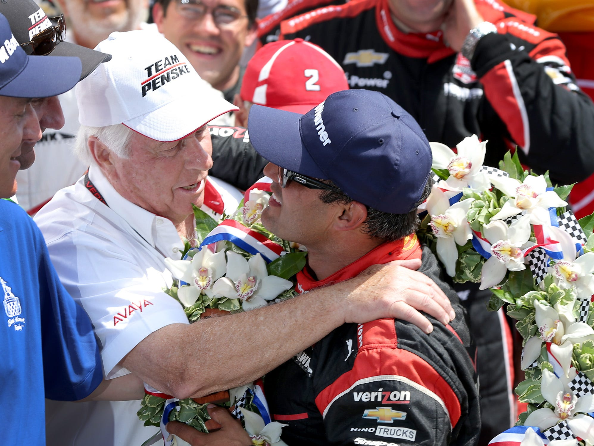 Juan Pablo Montoya (right) gave Roger Penske his record-extending 16th Indianapolis 500 victory in May.