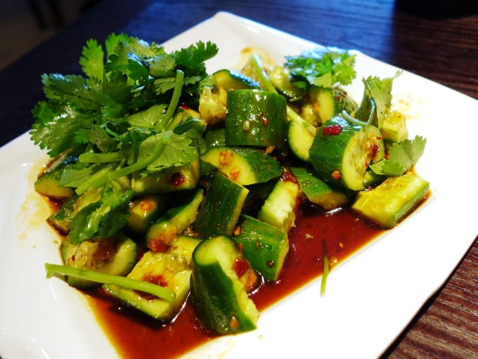 The spicy cucumber is chilled and doused in a light