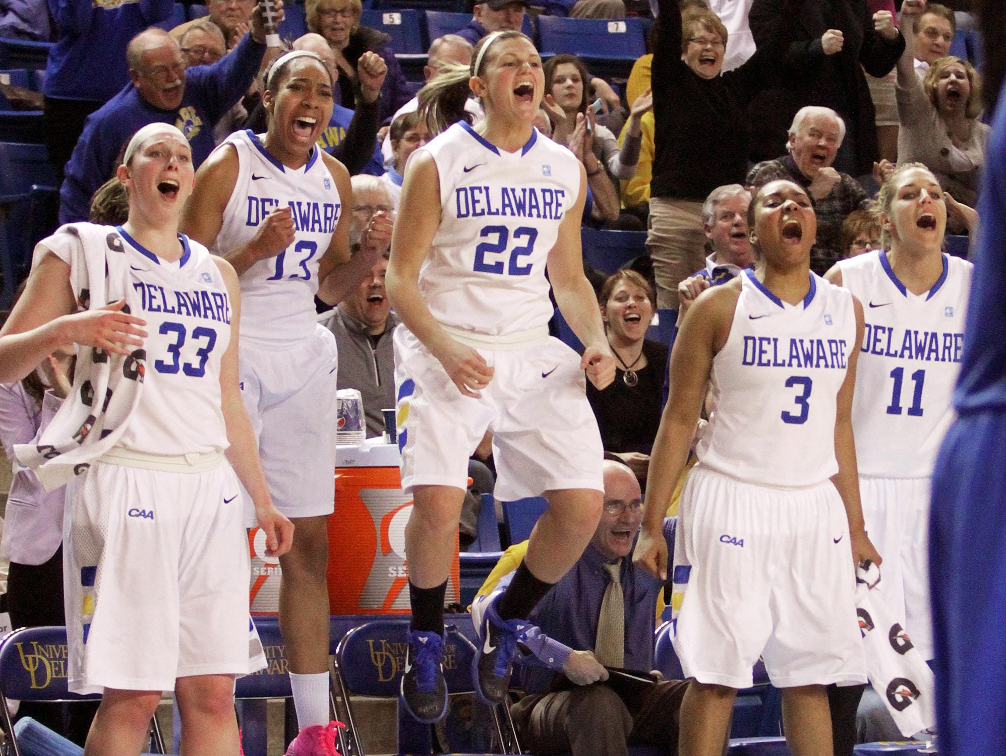 Delaware's (from left) Stephanie Leon, Kelsey Buchanan, Lauren Carra, Jaquetta May and Elena Delle Donne react as senior co-captain Chelsea Craig scores her first basket of the season late in the second half.