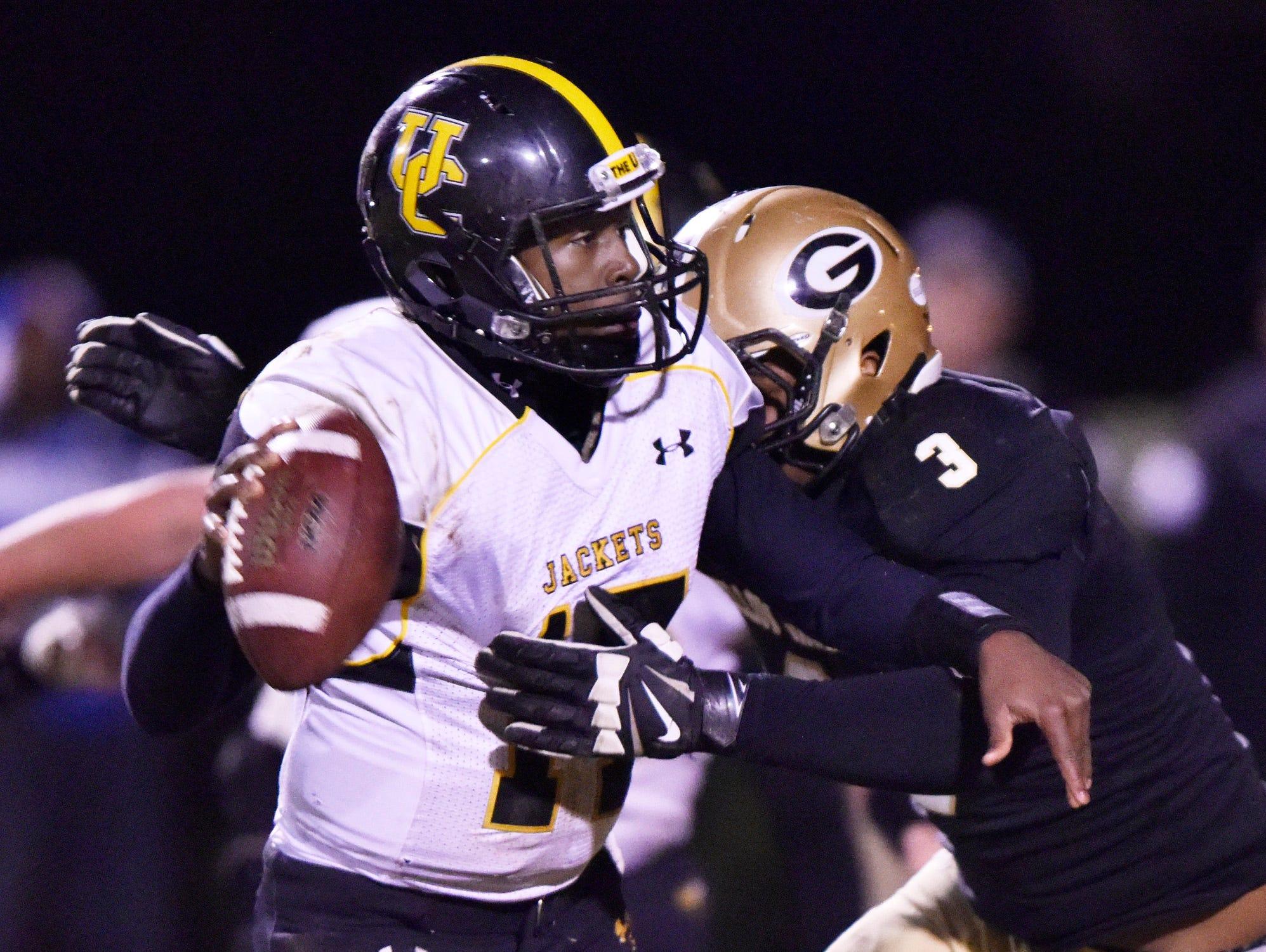 Greer's Quantavious Cohen (3) sacks Union County quarterback De'airrius Smith (17).