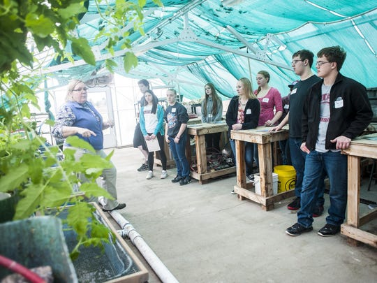 Diane Lund speaks to high school students about benefits of aquaponics and sustainable agriculture during University of Great Falls' Science Days in the DiRocco-Peressini Science Building on Wednesday.