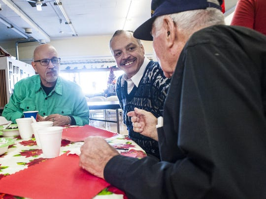 Ramon Kotwicki, left, and Martin Baca, center, talk to John Reynolds about his WWII experiences during the Danny Berg Memorial Dinner at the Great Falls Senior Center on Friday.