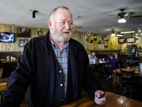 Jefferson County Commissioner Bob Mullen, standing in The River Pizza and Subs in Boulder, says the state is rushing the closure of the Montana Developmental Center.
