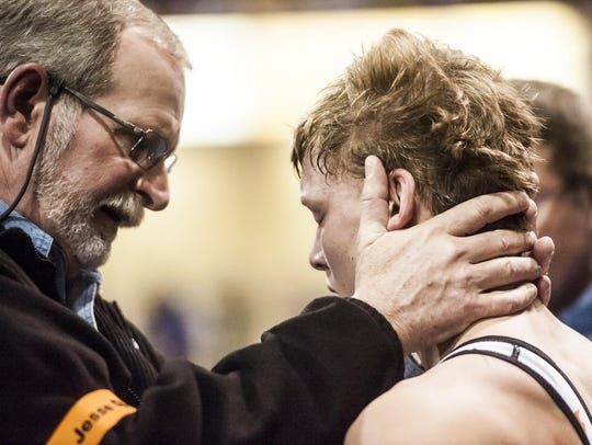 Chinook Coach Perry Miller talks to Tate Niederegger