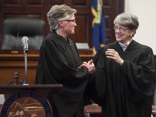 Elizabeth Best, left, greets Supreme Court Justice Patricia Cotter after being sworn in as the newest 8th Judicial District Judge at the Cascade County Courthouse on Monday.