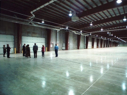City officials tour the nearly completed, 78,000-square-foot Federal Express Building at Great Falls International Airport in April 2000.