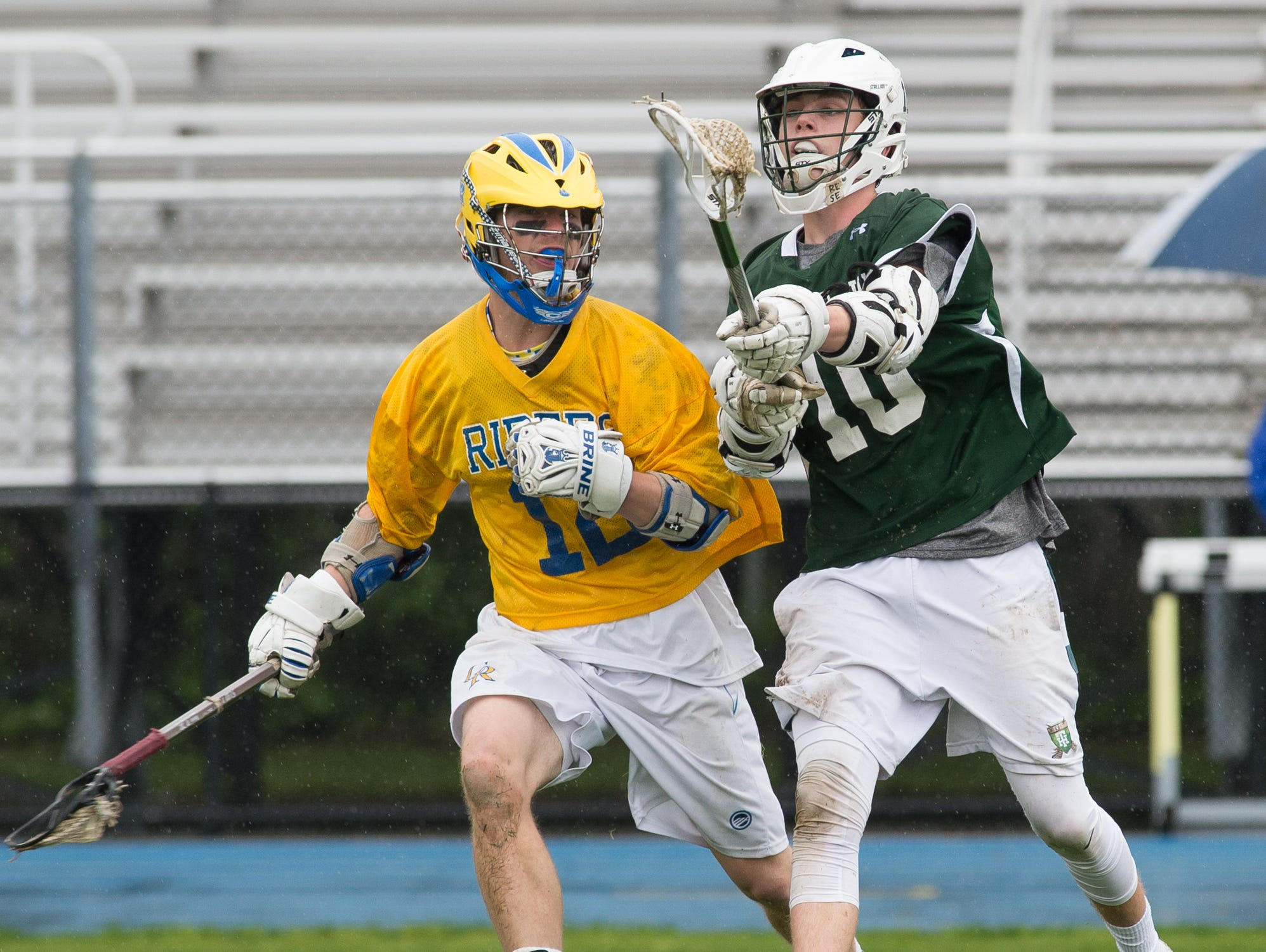 Tower Hill's James Spruance (10) right, passes the ball off as Caesar Rodney's Brinen Lefevre (12) defends.