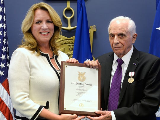 Air Force Secretary Deborah Lee James presents Anthony Duno with a certificate recognizing 70 years of federal service at Duno's retirement ceremony at the Pentagon in Washington D.C., July 22. Duno is the longest serving Air Force civilian.