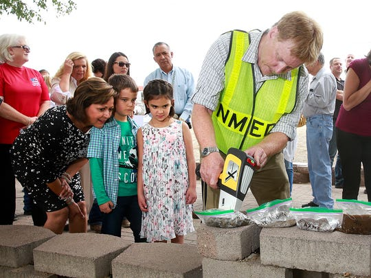 New Mexico Environment Department Chief Scientist Dennis McQuillan, center, tests sediment samples from the Animas River for heavy metals on Thursday along the Animas River trail in Farmington. Gov. Susana Martinez is pictured at left, along with Isaac Gabaldon, 8, and Grace Gabaldon, 6.