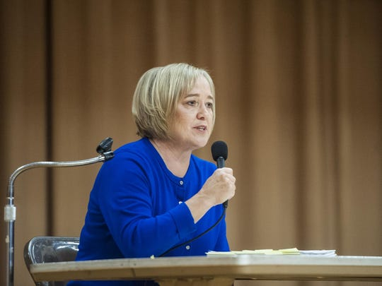 Kristen Juras speaks during a debate against Dirk Sandefur for a Montana Supreme Court position in West Elementary School on Thursday.