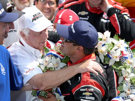 Juan Pablo Montoya, of Team Penske celebrates with team owner Roger Penske,left, after winning the 99th running of the Indianapolis 500, May 24, 2015, at the Indianapolis Motor Speedway.