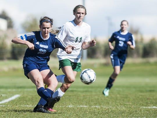 Great Falls High's Emma Madsen kicks the ball away