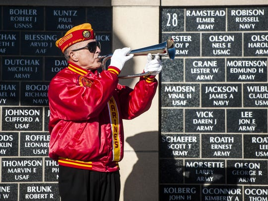 A Marine Corps League member plays taps during the Veterans Day Ceremony at the Montana Veterans Memorial, 1025 25th St. N. This year's ceremony begins at 11 a.m. Monday (Nov. 11).