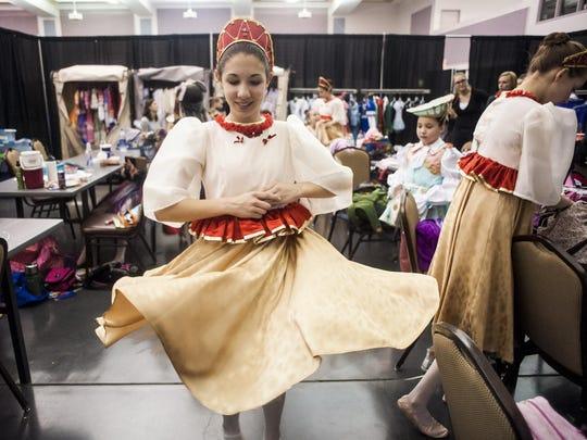 Jasmine Dougherty, 14, twirls in her snow maiden dress