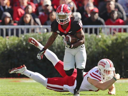 Georgia wide receiver Isaiah McKenzie breaks away from