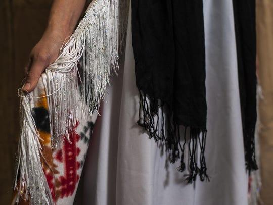 Mikalen Running Fisher wears a design by Belinda Bullshoe.