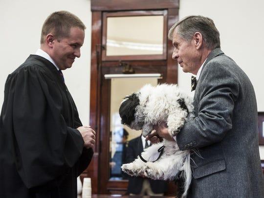 Marvin Harris holds Benny as Judge Greg Pinski recognizes
