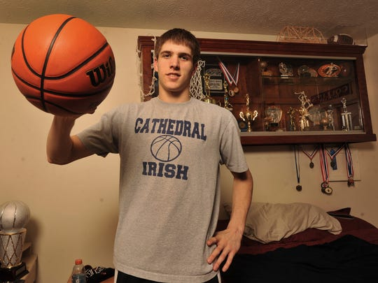 FILE – Cathedral's Collin Hartman in his room at home in Fishers with his trophy case, March 5, 2013.