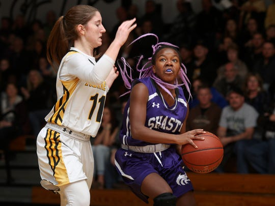 Shasta High's Rikkii Bennett dribbles against Enterprise's Karina Archibald during the first half of their NSCIF D-III semifinal Tuesday night. Shasta won 48-43.